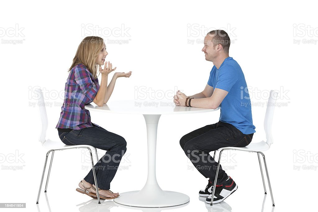 Couple sitting in a restaurant stock photo