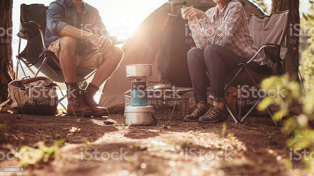 Couple sitting in chairs outside the tent stock photo