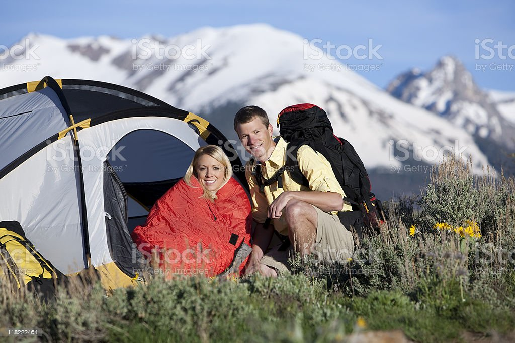 Couple Sitting In Front Of Tent Camping And Backpacking royalty-free stock photo