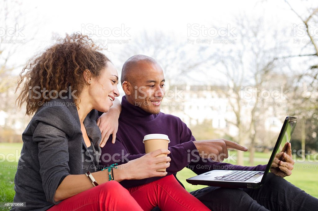 couple sitting in the park royalty-free stock photo