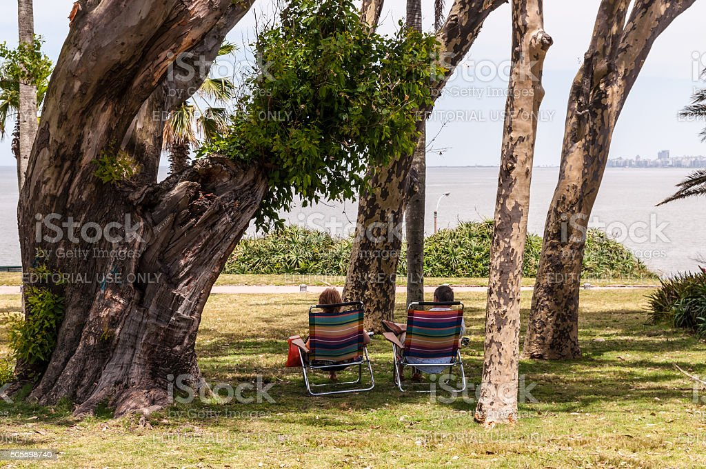 Couple sitting in the Park stock photo