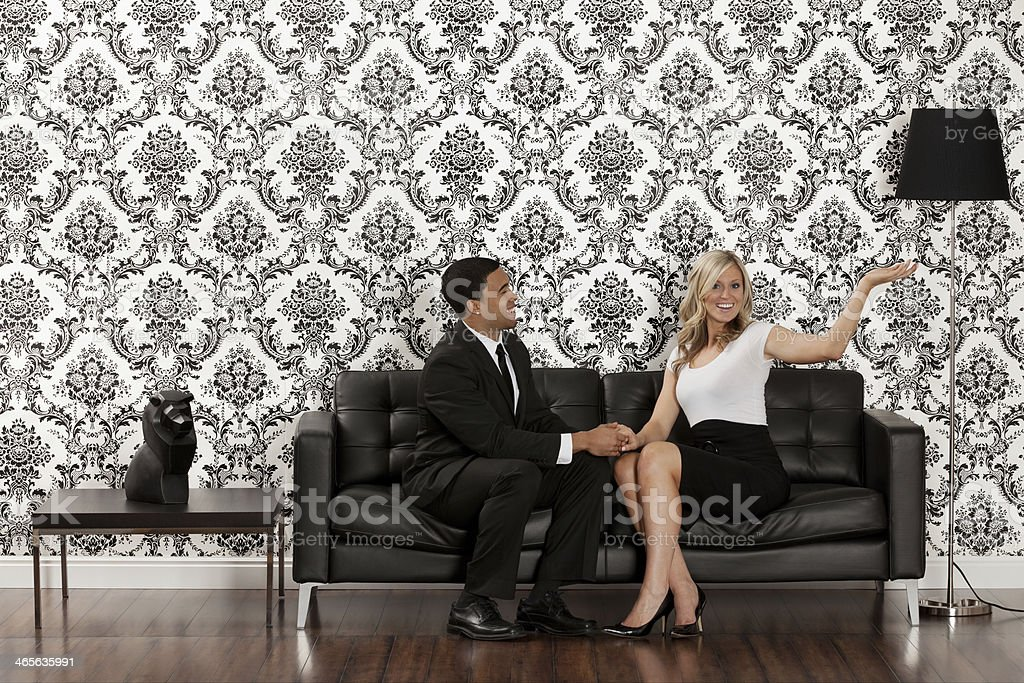 Couple sitting on a couch royalty-free stock photo
