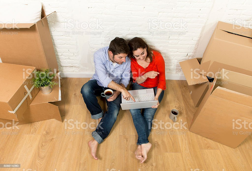 couple sitting on floor moving in new house apartment flat stock photo