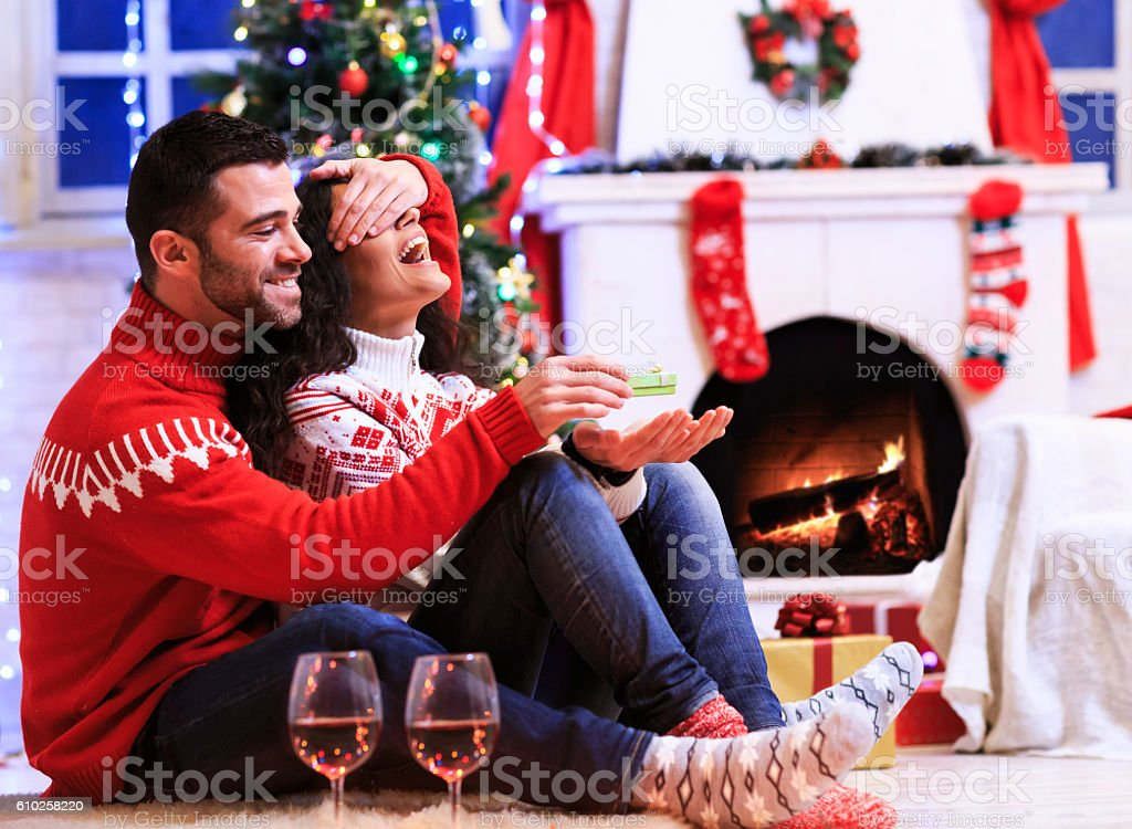Couple sitting on ground at home - engagement stock photo