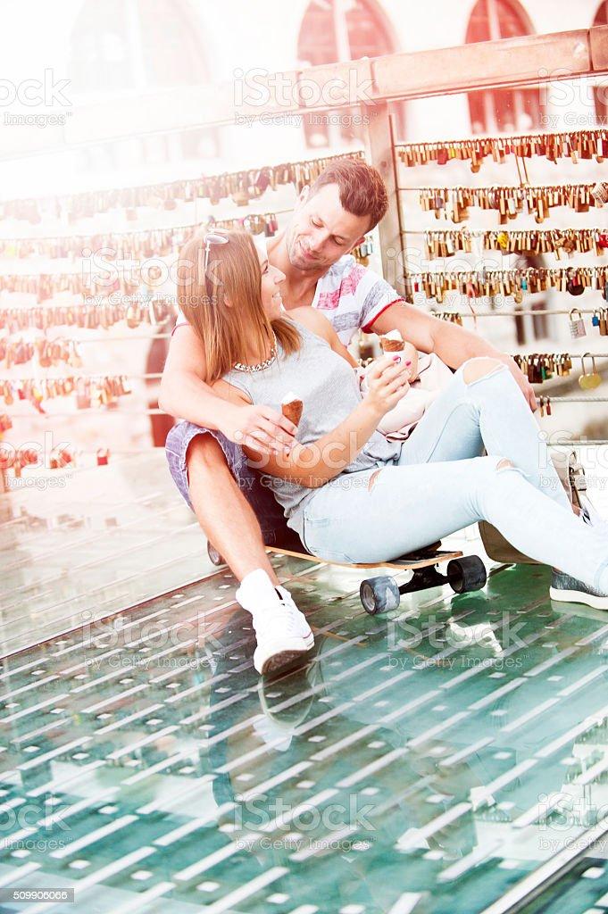 Couple sitting on longboard stock photo