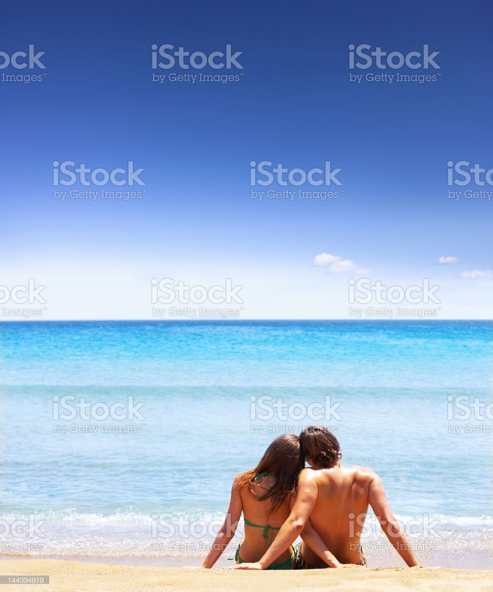 Couple sitting on the beach royalty-free stock photo