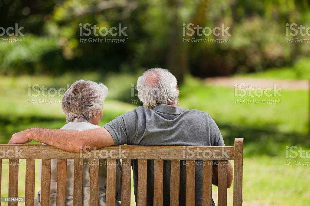 Couple sitting on the bench stock photo