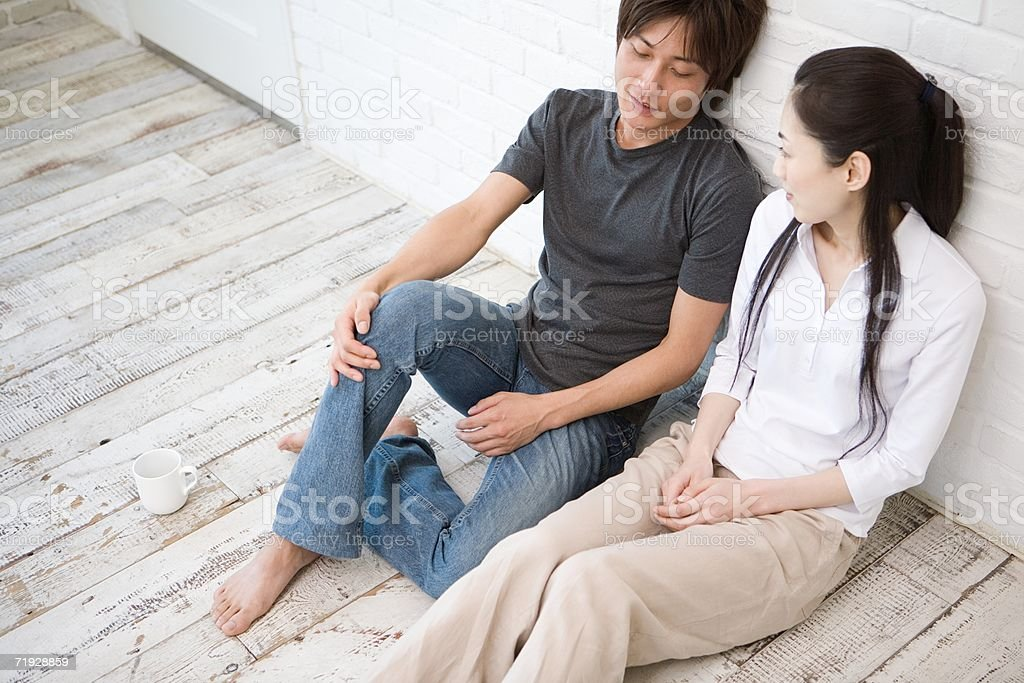 Couple sitting on the floor royalty-free stock photo