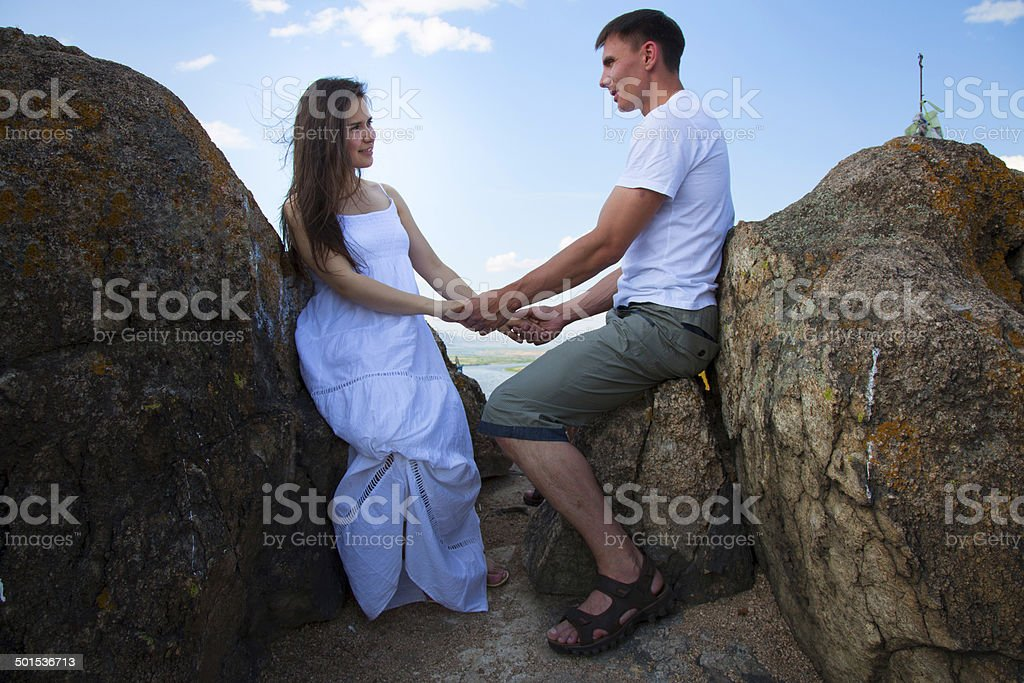 Couple sitting on the rocks royalty-free stock photo