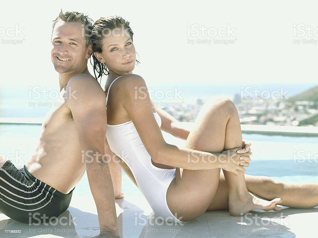 A couple sitting outdoors royalty-free stock photo