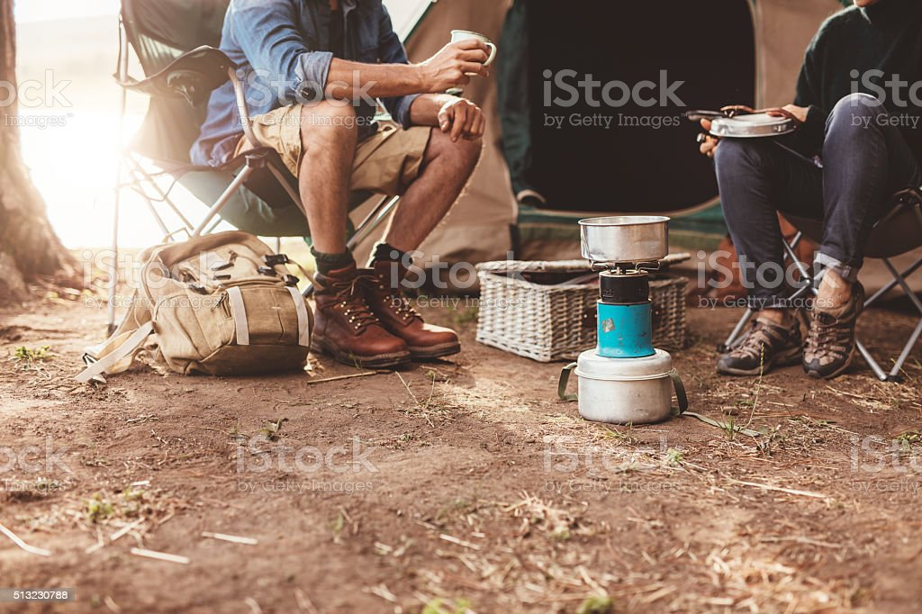 Couple sitting outside the tent stock photo