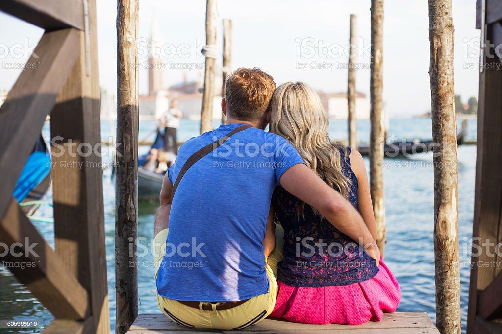 Couple sitting together and enjoying Venice stock photo