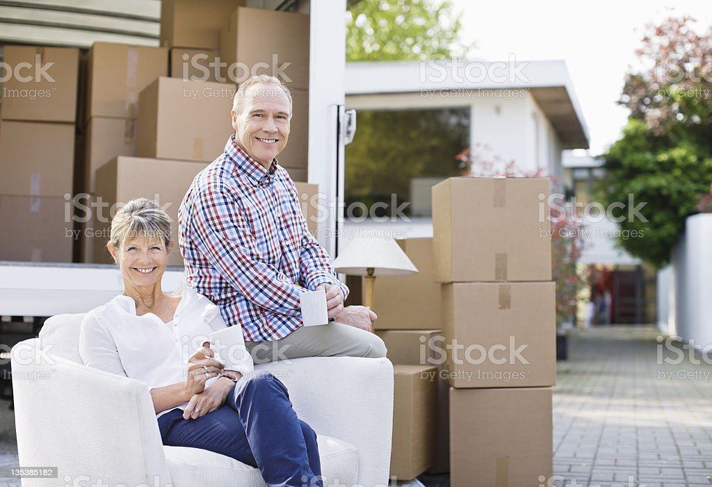 Couple sitting with moving and boxes stock photo
