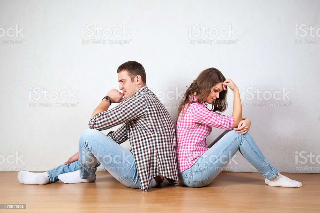 Couple sitting with their backs turned after having an argument stock photo