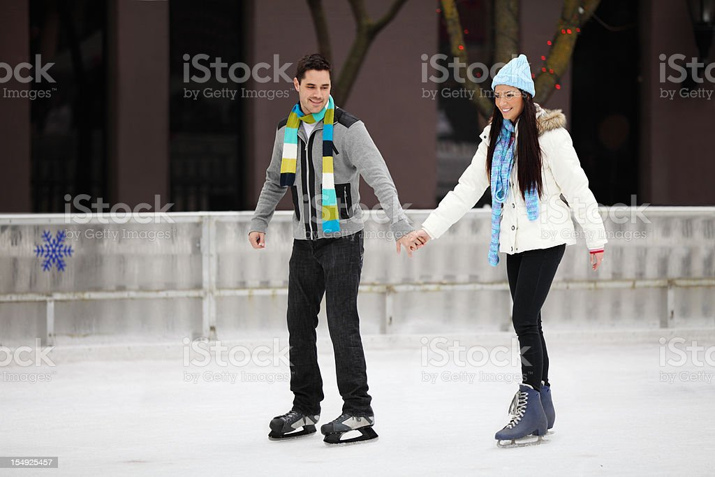 Couple Skating On Ice stock photo