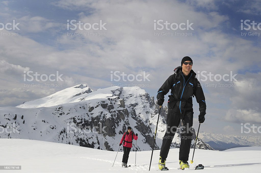 Couple ski touring hiking in the backcountry royalty-free stock photo