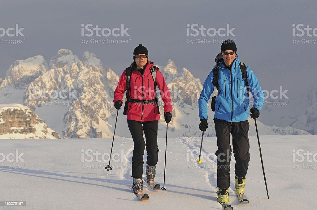 Couple ski touring in the alps - dolmites royalty-free stock photo