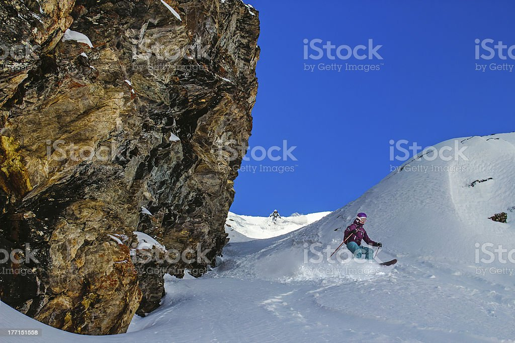 Couple skiers in a narrow couloir royalty-free stock photo