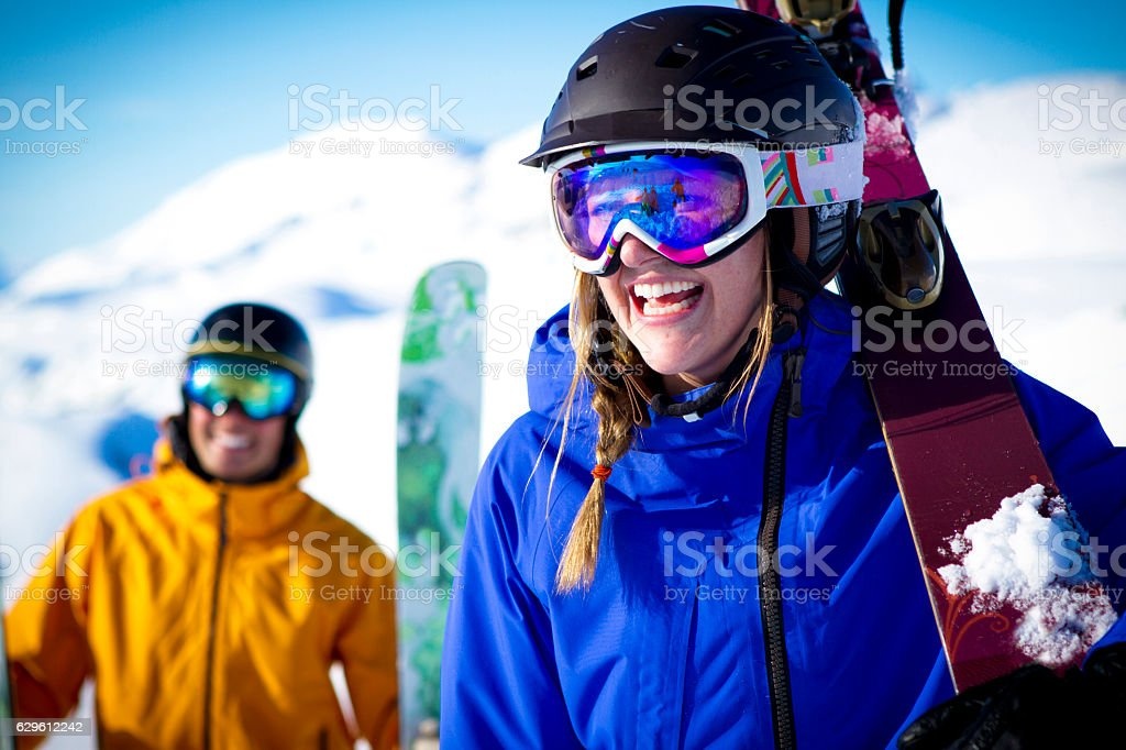 Couple skiers smiling in mountains. stock photo