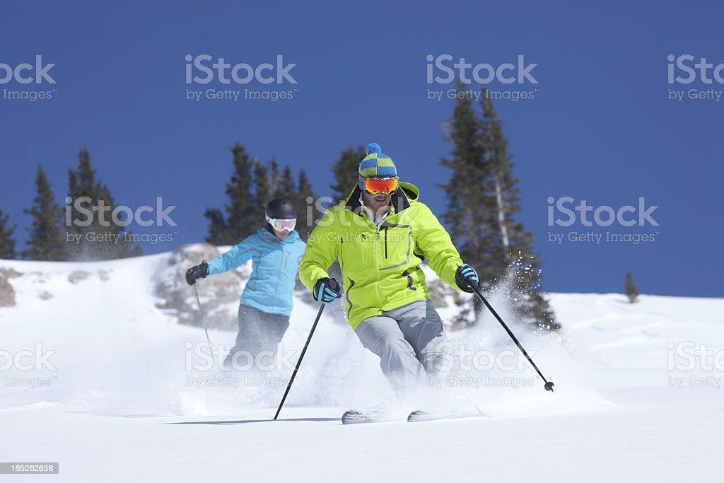 Couple skiing in fresh Powder snow, Colorado,USA stock photo