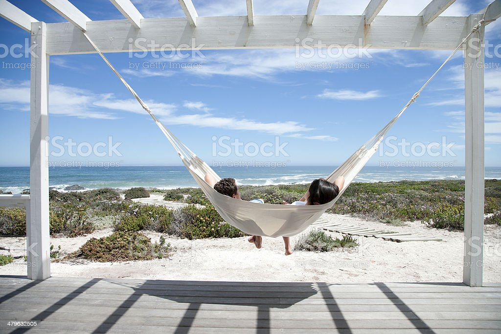 A couple sleeping in a hammock stock photo