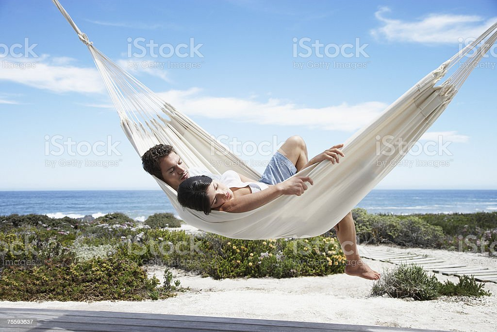 A couple sleeping in a hammock royalty-free stock photo