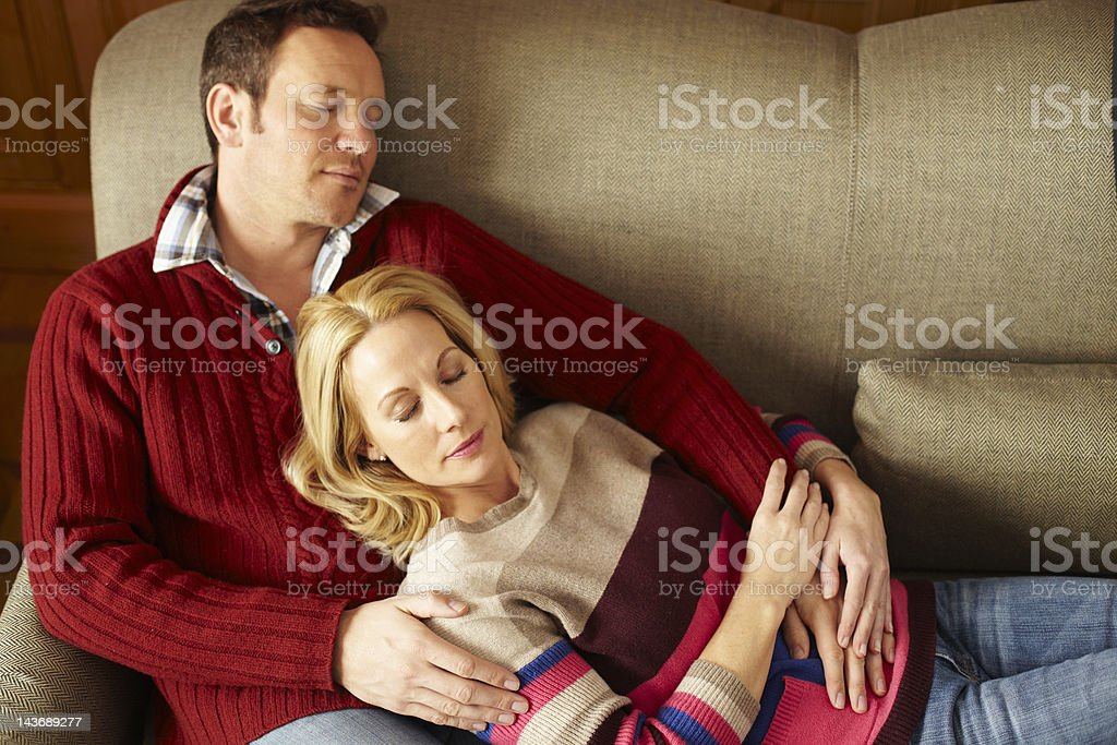 Couple sleeping on sofa together royalty-free stock photo