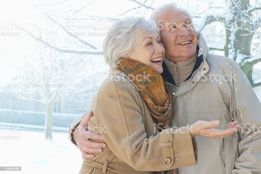 Couple smiling in snow royalty-free stock photo