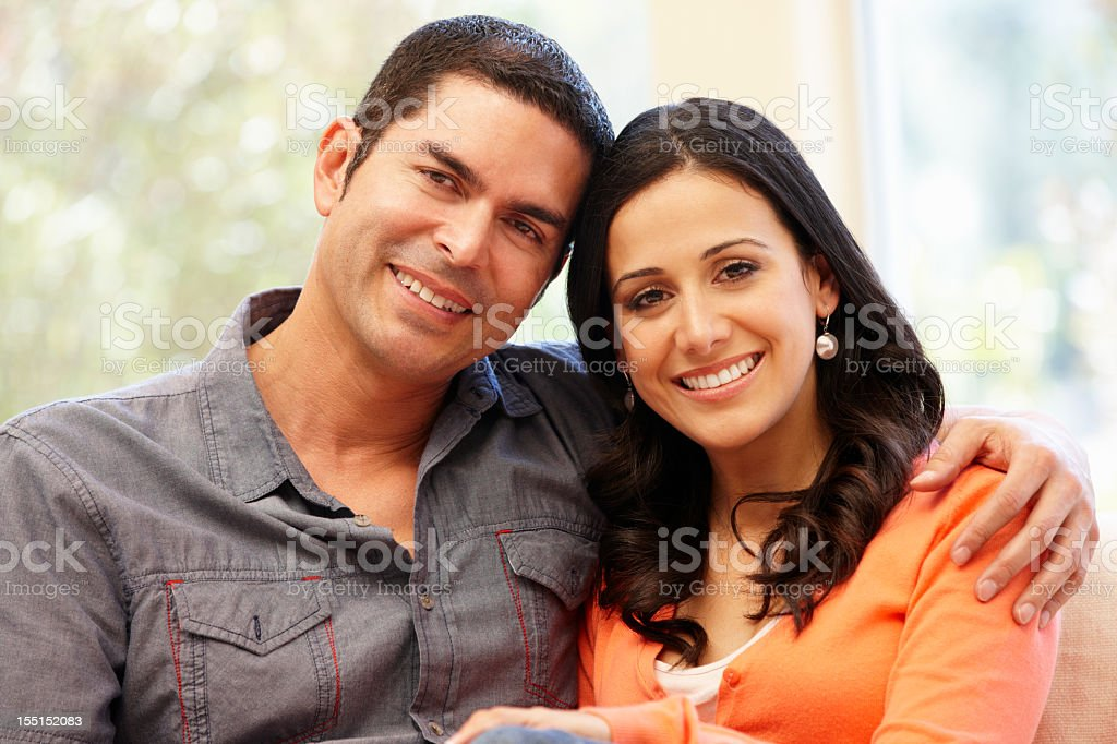 A couple smiling together at home royalty-free stock photo