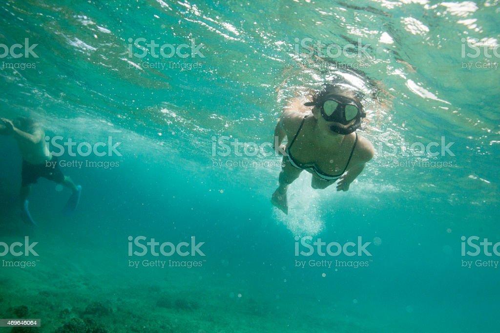 Couple Snorkeling in Hawaii stock photo