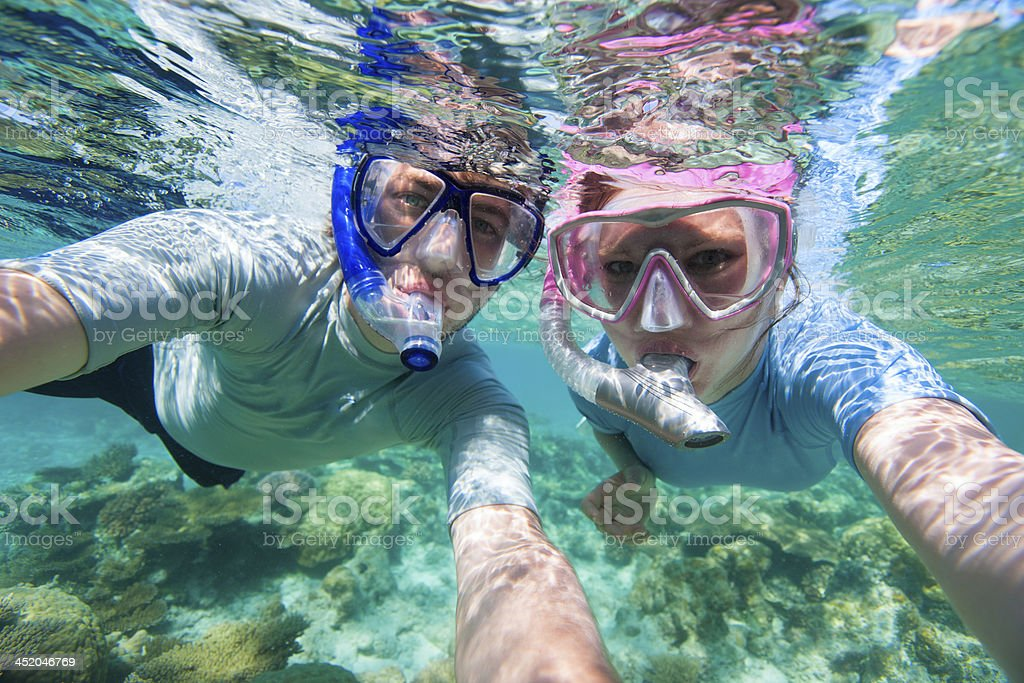 Couple snorkelling stock photo