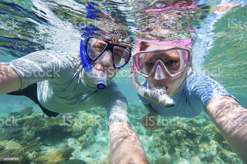 Couple snorkelling stock photo