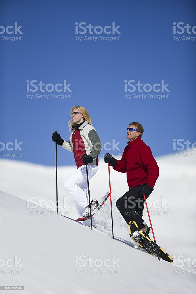 Couple Snowshoeing In Colorado USA royalty-free stock photo