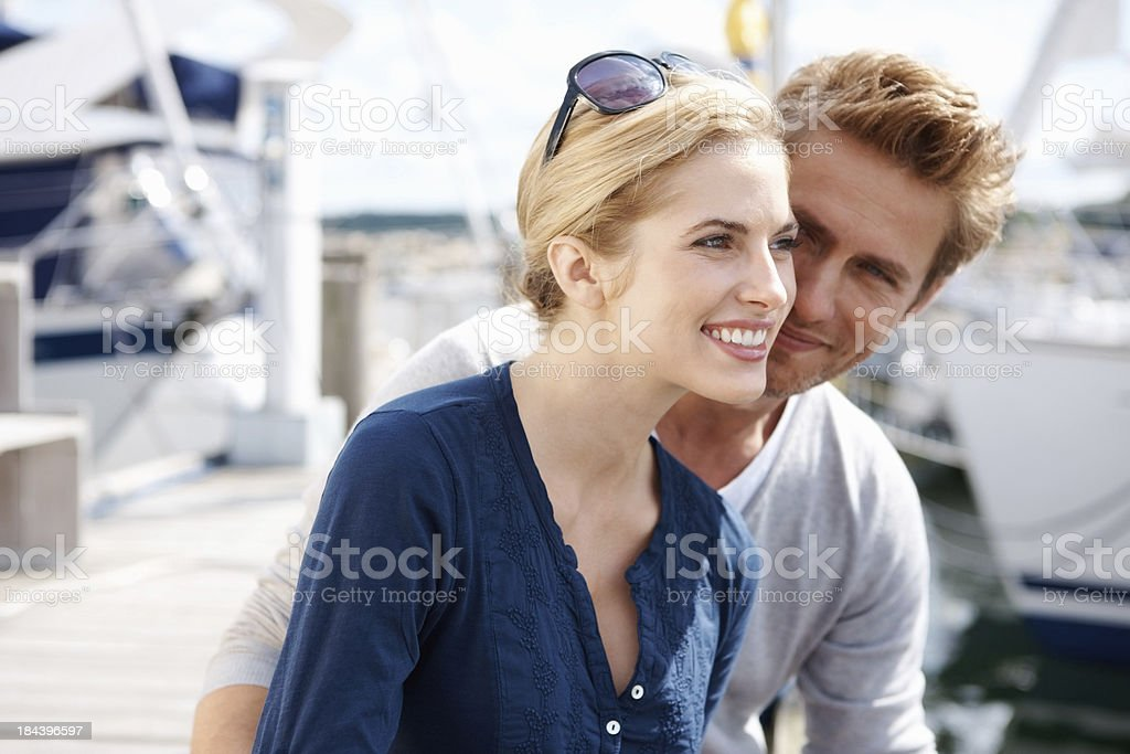 Couple spending time at harbor royalty-free stock photo