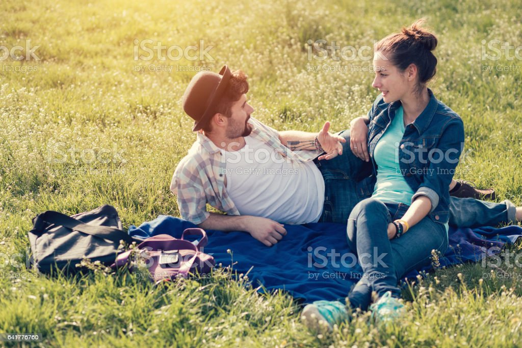 Couple spending time together in the city park stock photo