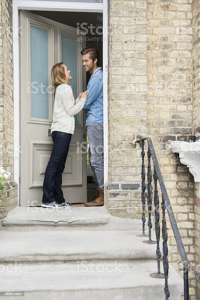Couple Standing At Doorway Of New Home stock photo