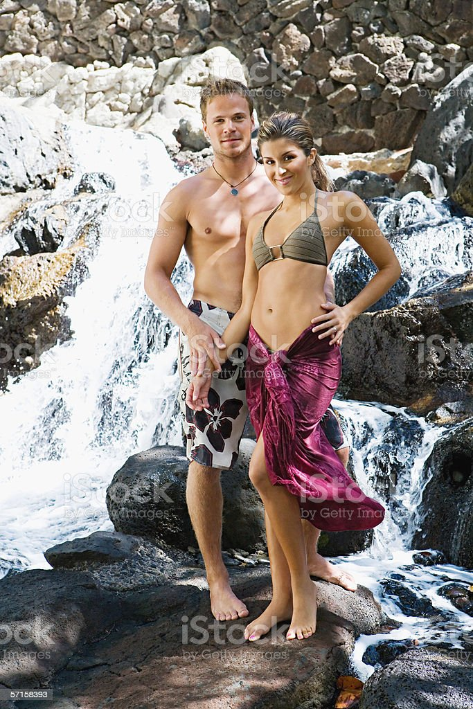 Couple standing by waterfall royalty-free stock photo
