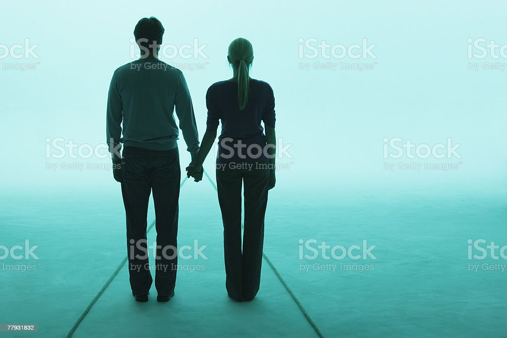 Couple standing holding hands royalty-free stock photo