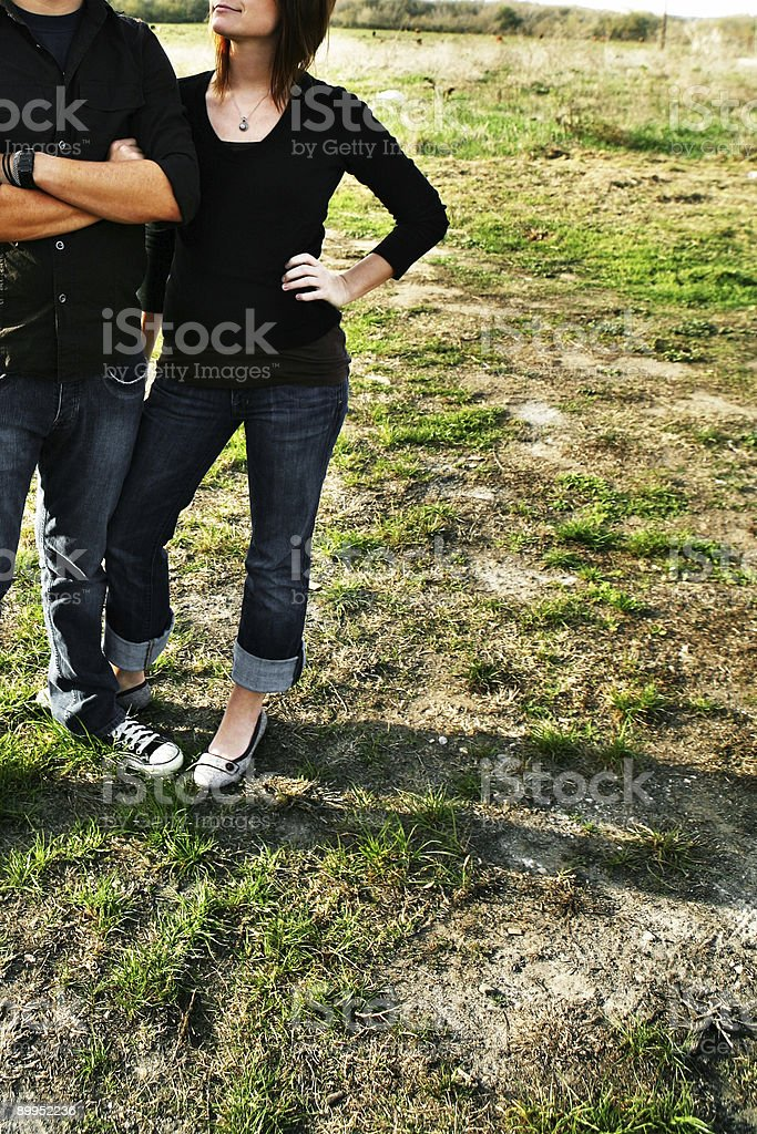 Couple Standing in a Dried Field royalty-free stock photo