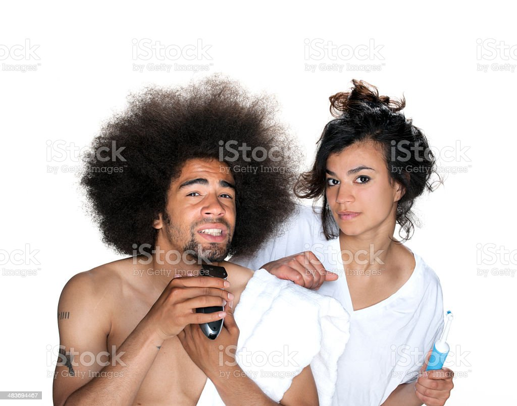 couple standing in bathroom with tooth brush and razor stock photo