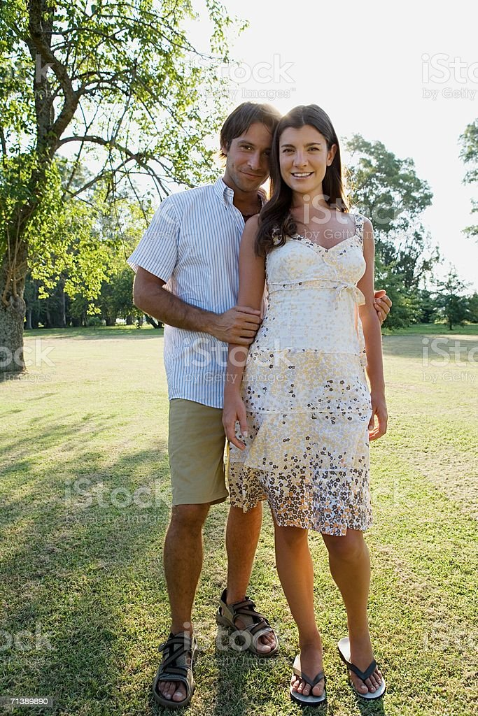 Couple standing in garden royalty-free stock photo