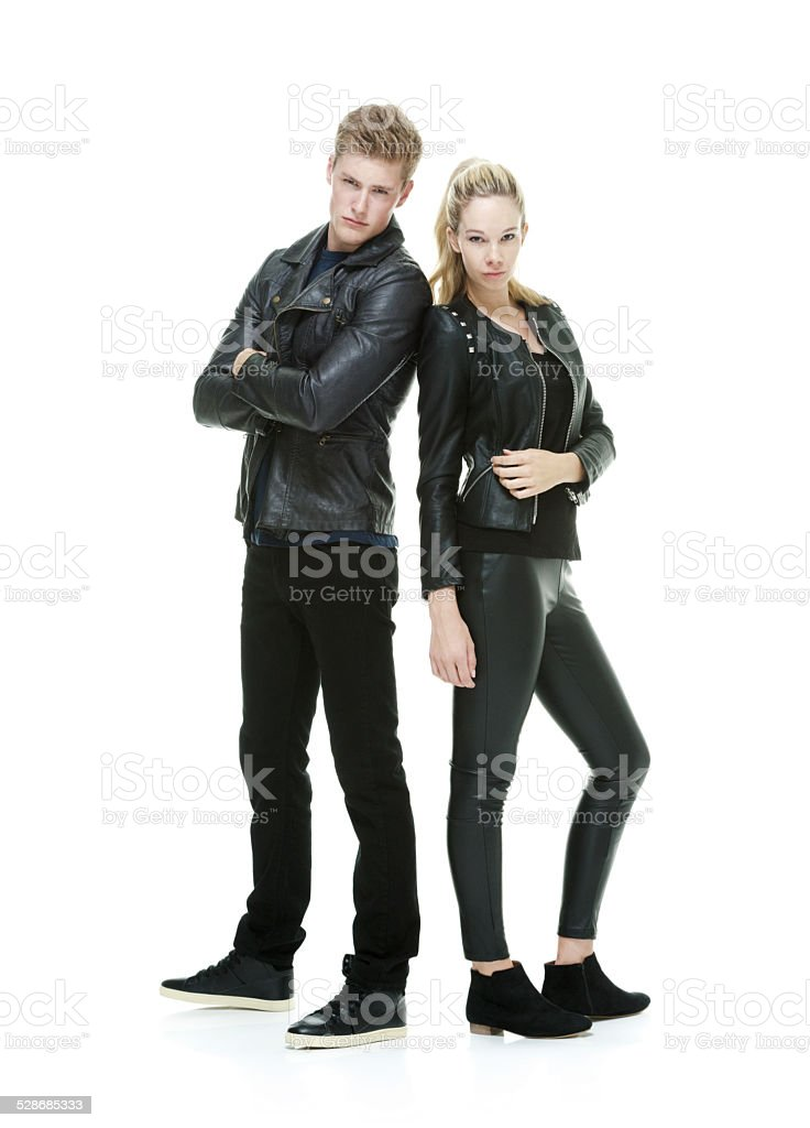 Couple standing & looking at camera stock photo