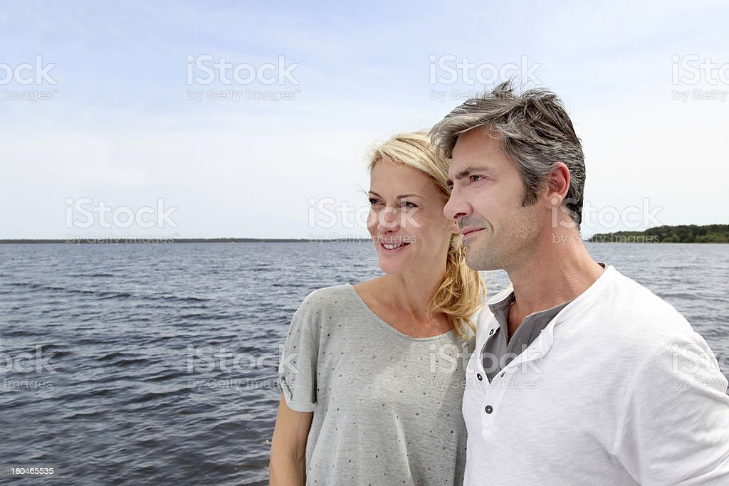 Couple standing near a lake royalty-free stock photo