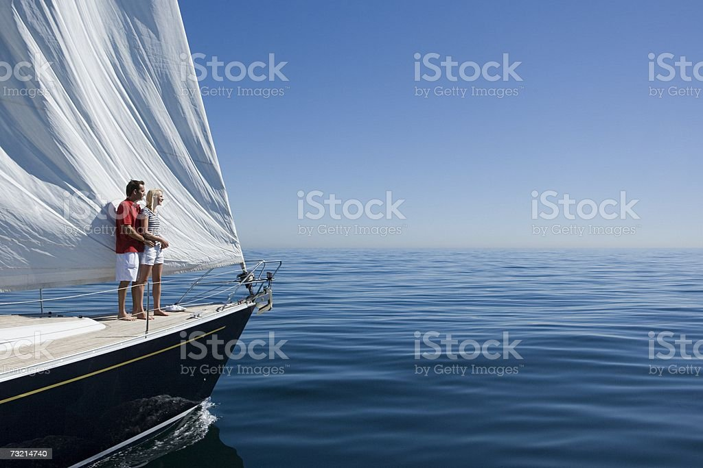 Couple standing on a ships bow stock photo