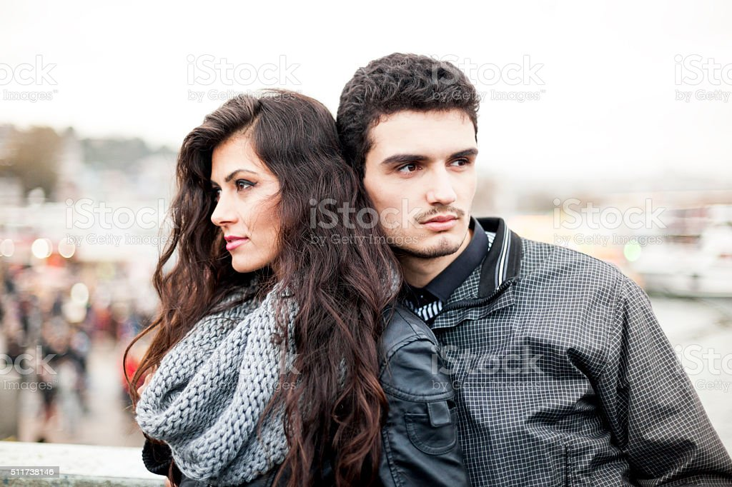 Couple Standing Side by Side on a City Bridge stock photo