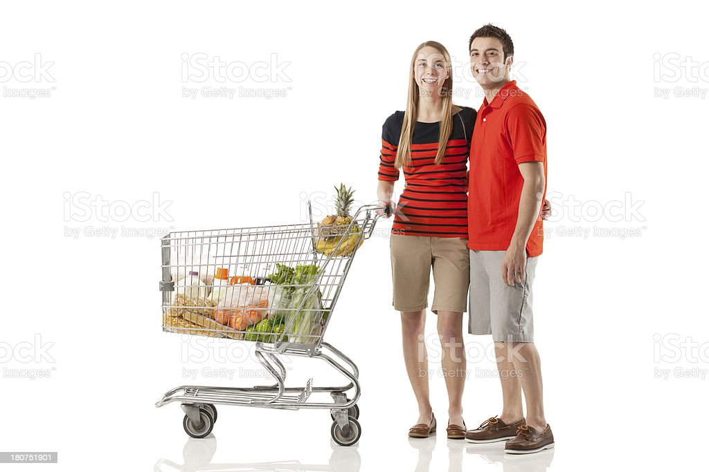 Couple standing with shopping cart royalty-free stock photo