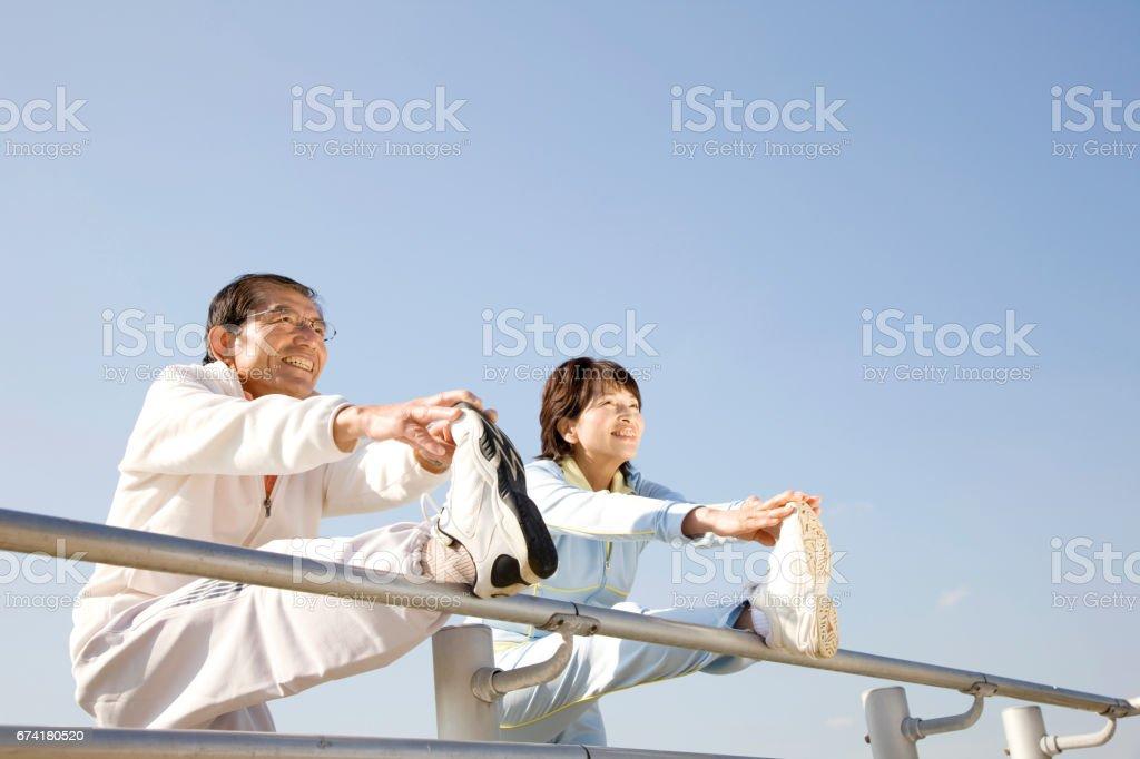 Couple stretching stock photo