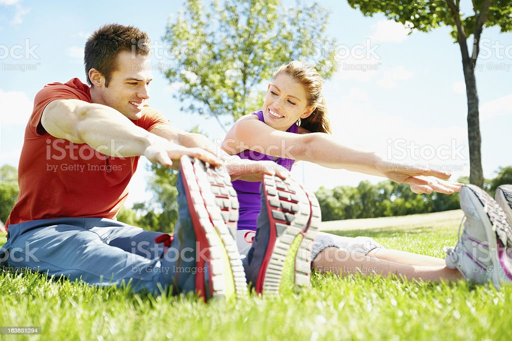 Couple stretching together royalty-free stock photo