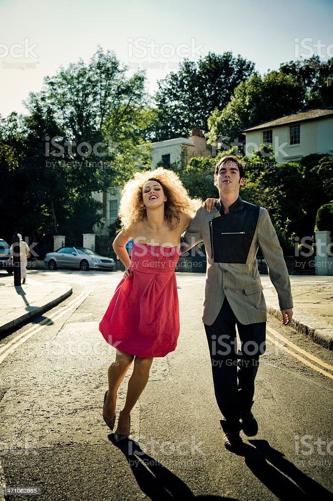 couple stumbling down the streets royalty-free stock photo