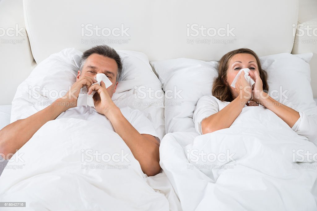Couple Suffering From Cold stock photo